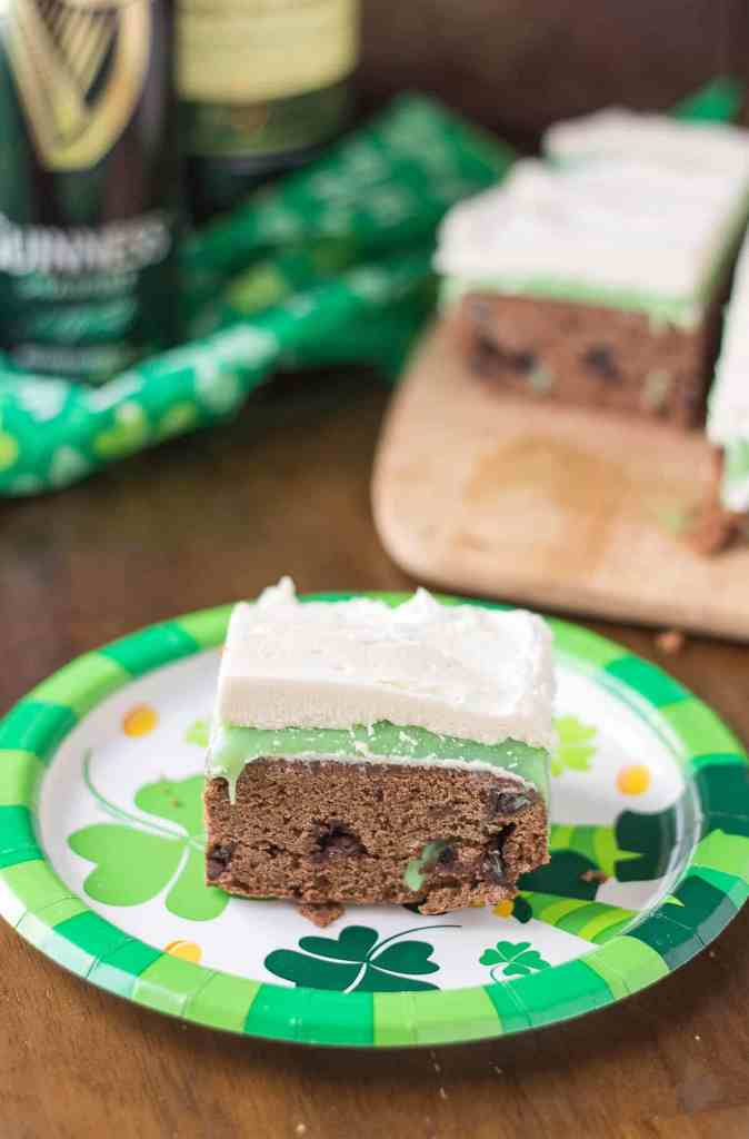 Guinness Stout Chocolate Brownies, Jameson White Chocolate Ganache and Baileys Buttercream frosting are what these Irish Car Bomb Brownies are made of! Decadently sweet, these brownies will satisfy any sweet tooth, even those who aren't lucky enough to be Irish! | Strawberry Blondie Kitchen