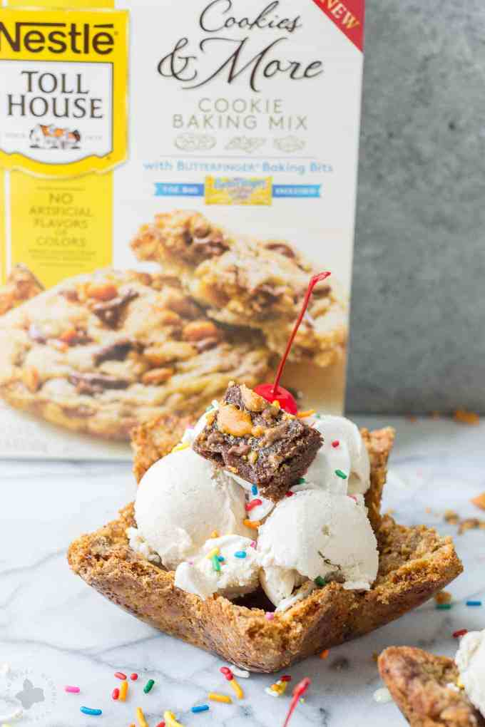 Freshly baked chocolate chip cookies are molded into bowls and piled high with all your favorite ice cream sundae favorites. Now you can have your ice cream and eat the bowl too! The Ultimate Ice Cream Sundae Bowl are an ice cream lovers dream. | Strawberry Blondie Kitchen