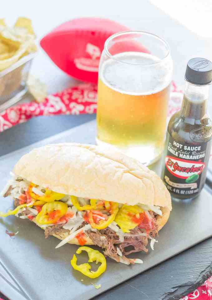 Bolillo rolls are filled with juicy, tender slow cooked beef short ribs, El Yucateco® hot sauce and melty cheese to bring you the ultimate Short Rib Sandwiches. | Strawberry Blondie Kitchen