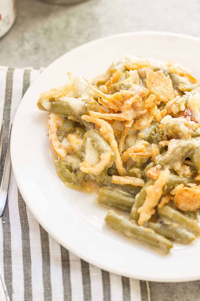Sharp white cheddar cheese elevates this Slow Cooker White Cheddar Green Bean Casserole to make it the star side dish of your holiday table!   Strawberry Blondie Kitchen