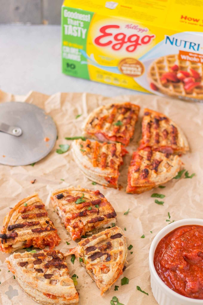 Get the kids into the kitchen and mix up your Eggo waffles. Start with an ingredient bar full of their favorite pizza toppings to create these fun Pizza Wafflewiches. | Strawberry Blondie Kitchen