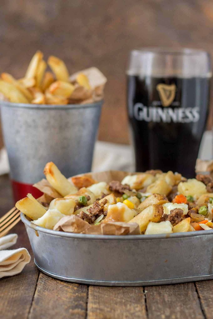 Crispy fries piled high with beef and mixed vegetables, smothered in Guinness gravy and topped with cheese curds make for one awesome Shepherd's Pie Poutine.   Strawberry Blondie Kitchen