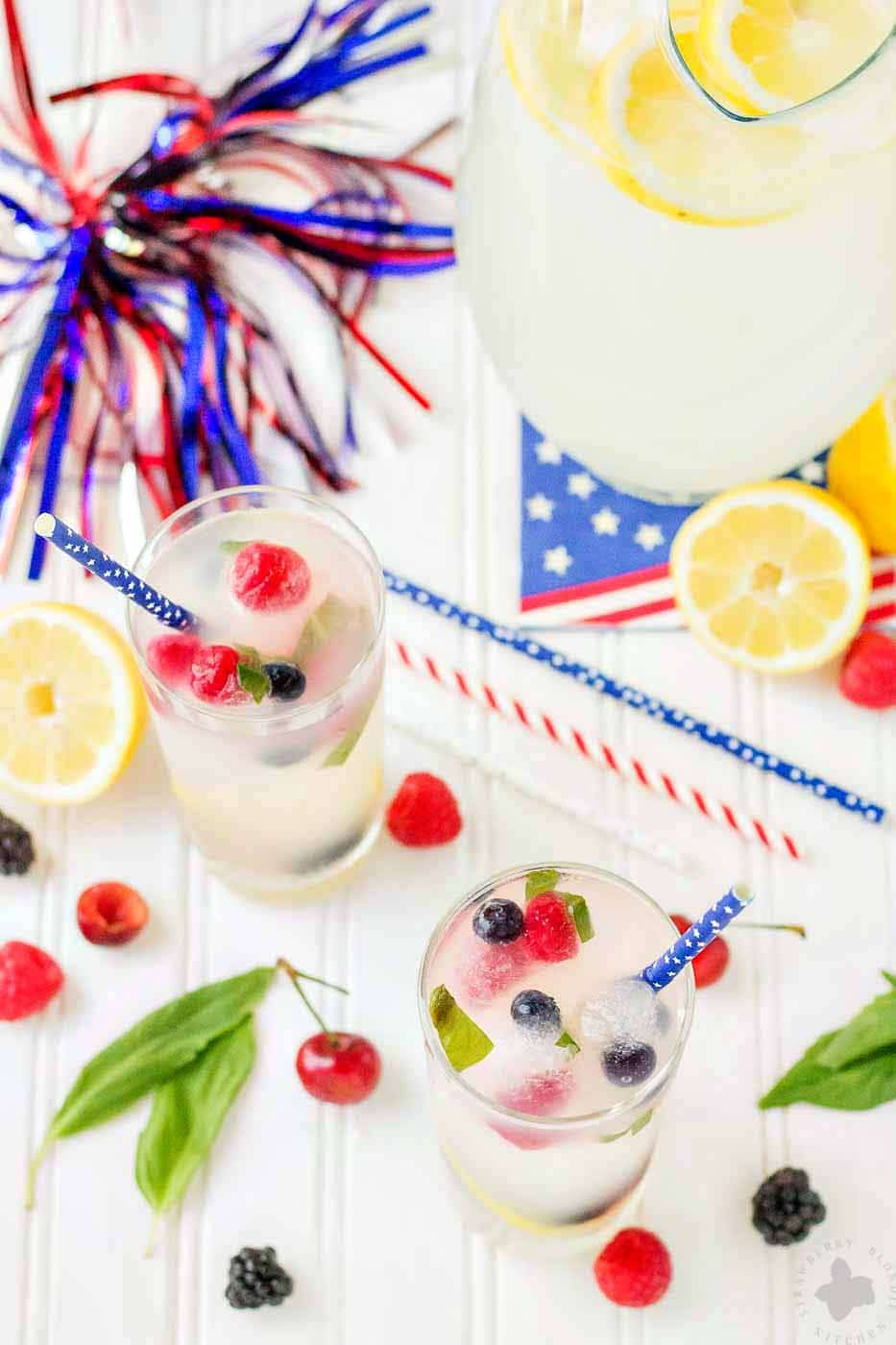 Refreshing and delicious, this Spiked Triple Berry Basil Lemonade is a perfect balance of sweet and tart. Smirnoff® Red, White and Berry vodka mixed with tart lemonade and fresh, sweet berries is the ultimate summertime cocktail! | Strawberry Blondie Kitchen