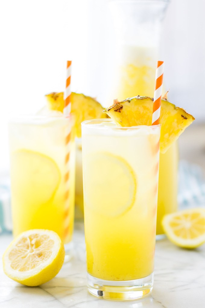 Pineapple pairs with spicy ginger and tart lemonade in sweet harmony to create this Pineapple Ginger Lemonade that is worthy of your next summertime sipper! | Strawberry Blondie Kitchen
