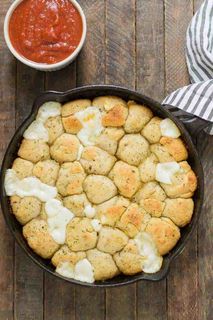 Savory bites of gooey cheese and garlic, these Garlic Cheese Bombs will be your new go to appetizer, snack or side dish for any occasion!   Strawberry Blondie Kitchen