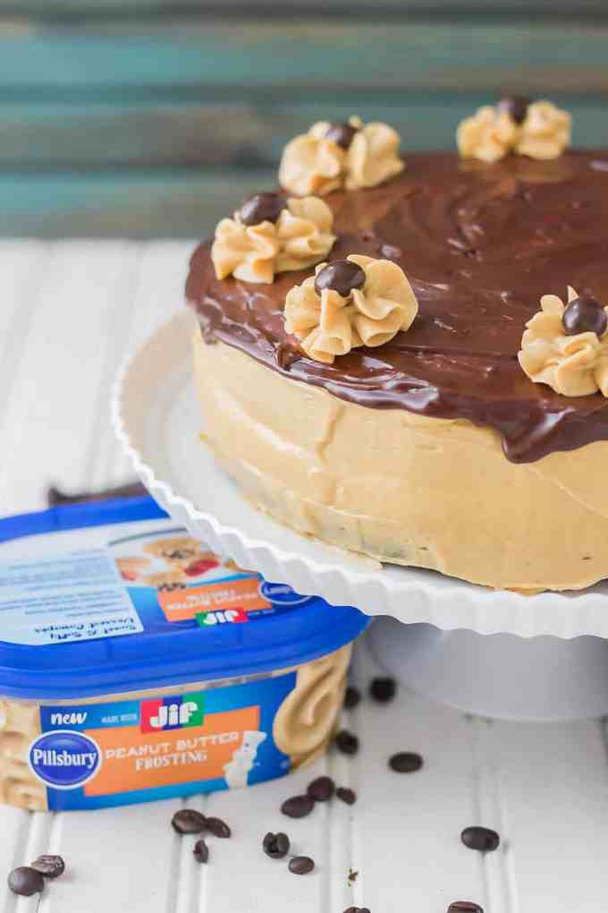 Rich chocolate espresso cakes are layered with Pillsbury™ Peanut Butter Frosting made with real Jif® Peanut Butter to create this Peanut Butter Espresso Cake which is the ultimate cake lover's dream! | Strawberry Blondie Kitchen