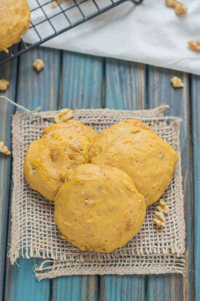 A delicious, puffy and cake like pumpkin nut cookie that is packed full of cinnamon, ginger, nutmeg and walnuts. A cookie worthy of all your Fall get togethers.  | Strawberry Blondie Kitchen