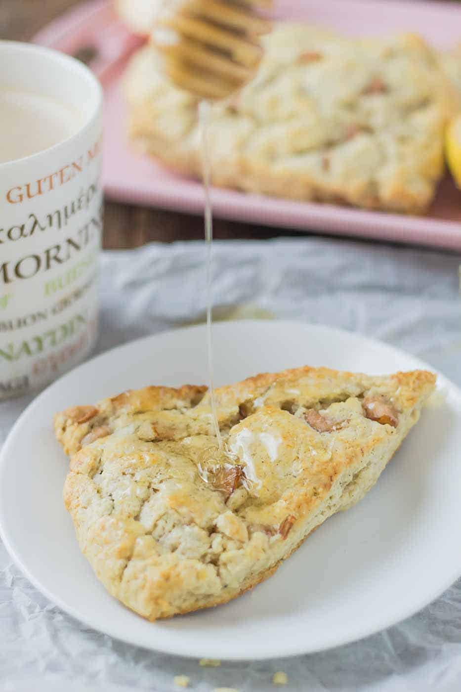Soft and sweet, with pillows of pear and rich blue cheese and a drizzle of honey, these Pear and Blue Cheese Scones are the perfect pair with your morning cup of coffee! | Strawberry Blondie Kitchen
