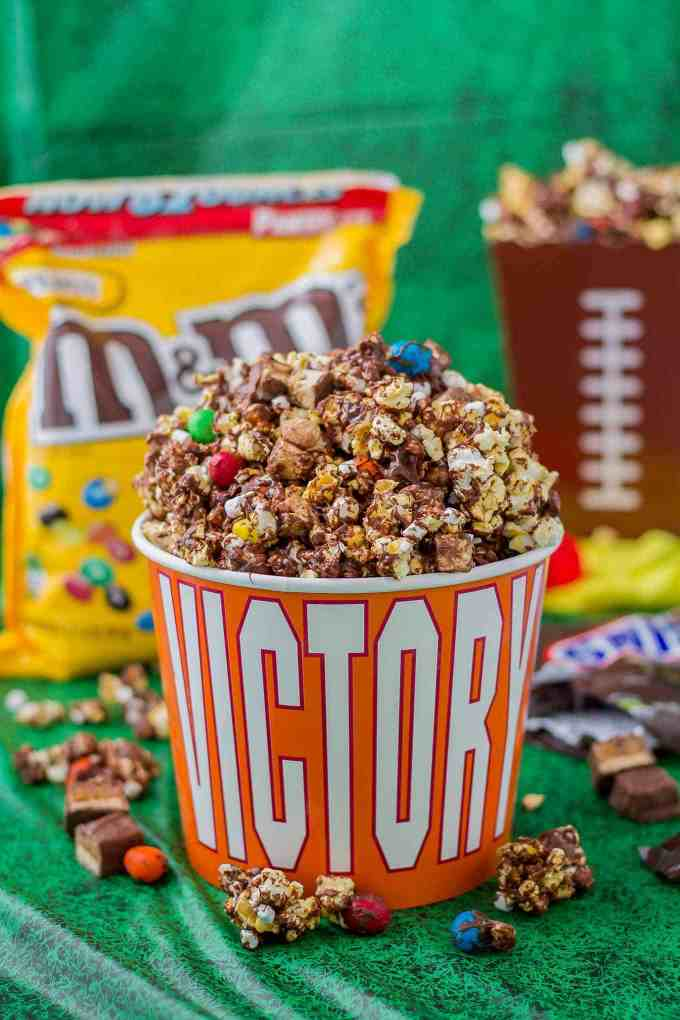 Rocky Road to Victory Popcorn is a game day lovers dream.  Rich chocolate, salty popcorn and bits of candy pieces make this popcorn mix a must have at your next home gate! | Strawberry Blondie Kitchen