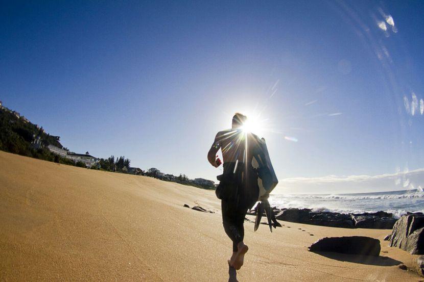 Bevan-running-to-the-beach-in Ballito