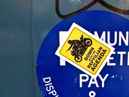 down with the reptilian agenda sticker on the streets of NYC