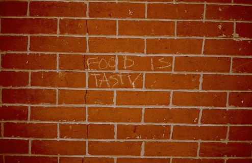 food is tasty scrawled on the wall in NYC
