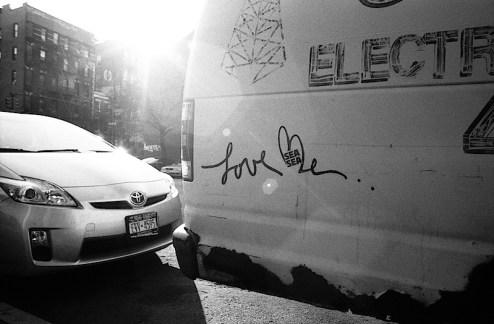 street artist love me's work on a van in NYC