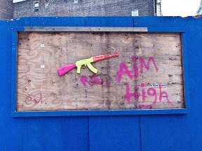 aim_high_toy_ak_47_street_art_soho_nyc.jpg