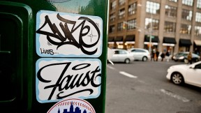 sure_lives_sticker_and_faust_graffiti.jpg