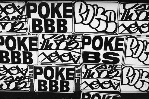 Poke graffiti stickers in SoHo, NYC