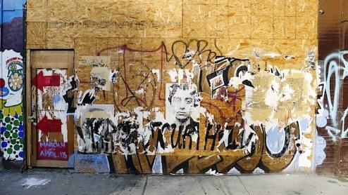 wheatpaste street art on the westside highway of NYC