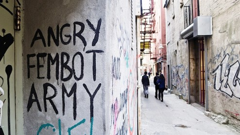 angry femboy army graffiti in an alleyway in NYC