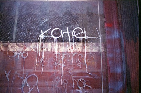 graffiti by katsu shot with a nikon f4 and lomographic 400 speed film found in NYC