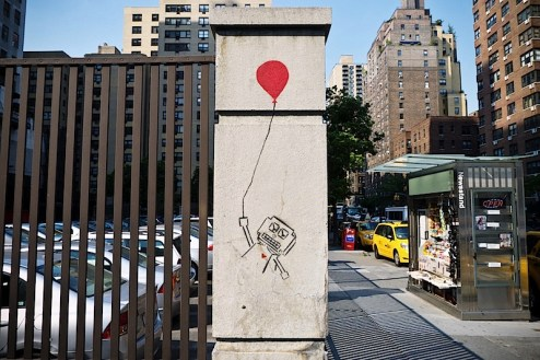 a robot with a balloon street art found on NYC's 14th street