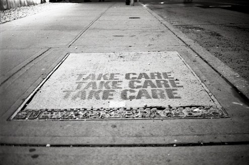 take care street art graffiti found in the east village of NYC