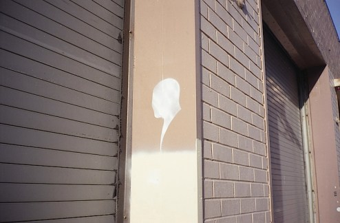 a silhouette profile image of someone in street art found in NYC