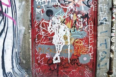 a joker wheatpaste in freemans alleyway of NYC