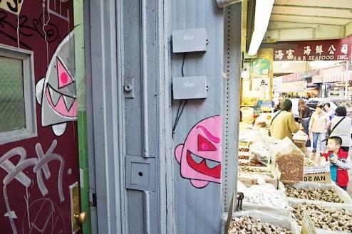 monster street art found on mott street in NYC