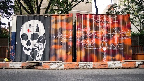 street art by skullphone and infinity in the east village of NYC