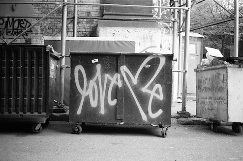 graffiti by love me curtis kulig spraypainted on a dumpster in SoHo, NYC