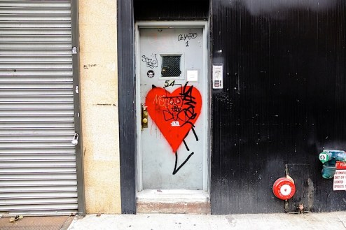 a graffiti heart and skull with a tophat found in chinatown nyc