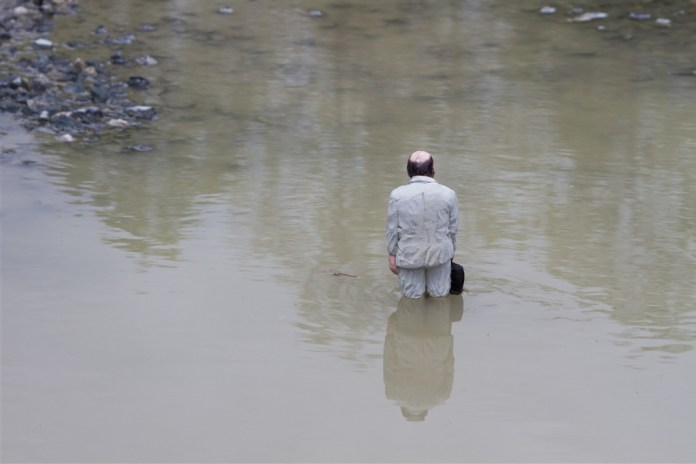 Waiting for climate change. Nantes, France. Cement Eclipses -By Isaac Cordal 2013 in 15
