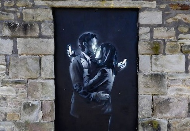 Phone Lovers – By Banksy in Bristol, England
