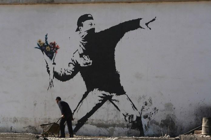 Banksy Graffiti Art On West Bank Barrier