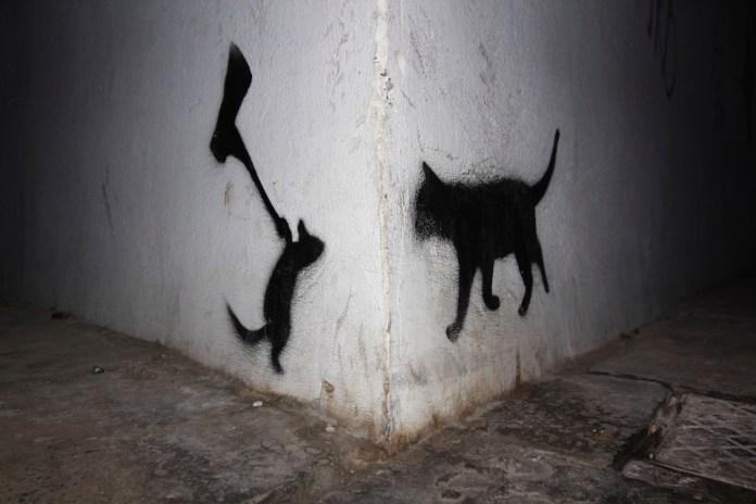 Just around the corner - Street Art in Kalamata, Greece. Mouse vs Cat
