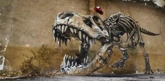 Graffiti of a dinosaur skeleton by SCAF in Lorraine, France
