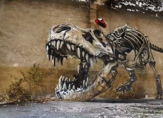 Graffiti of a dinosaur skeleton by SCAF in Lorraine, France