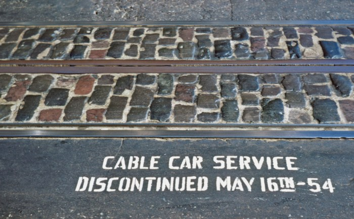 Notice of service discontinuation painted along the cable car tracks. Walt Vielbaum photo.