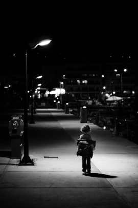 kid taking of jacket in the night