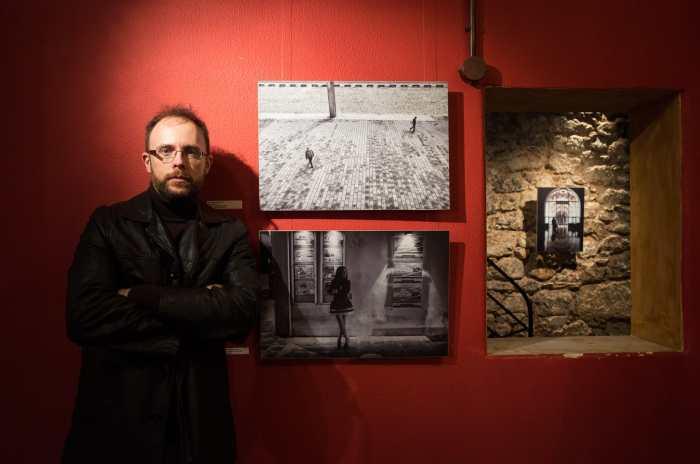 "Spyros Papaspyropoulos posing next to his photo ""Date Night"""