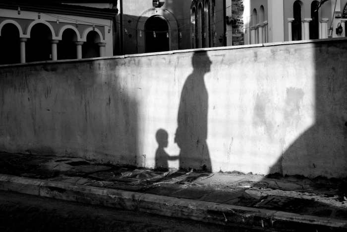"""Shadows telling a story"" street photograph by Makis Makris"