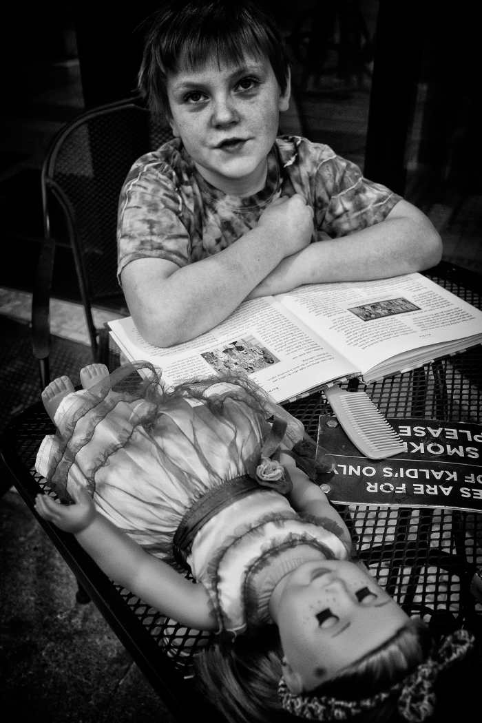 """A boy and his doll"" by Jon Luvelli"