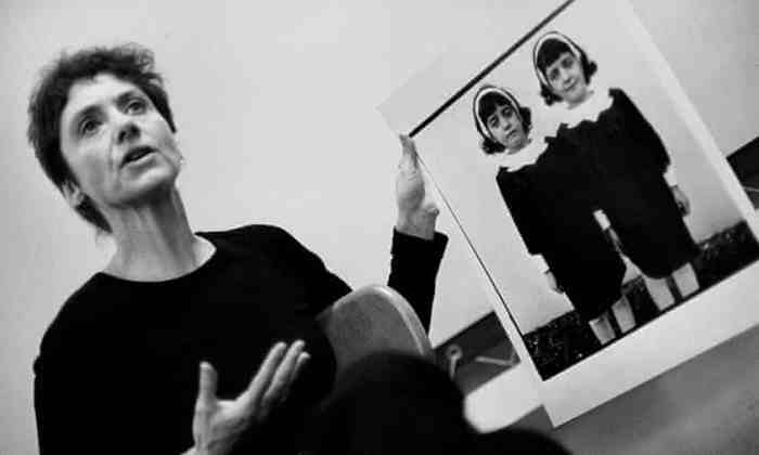 Diane Arbus showing her portrait of the twins