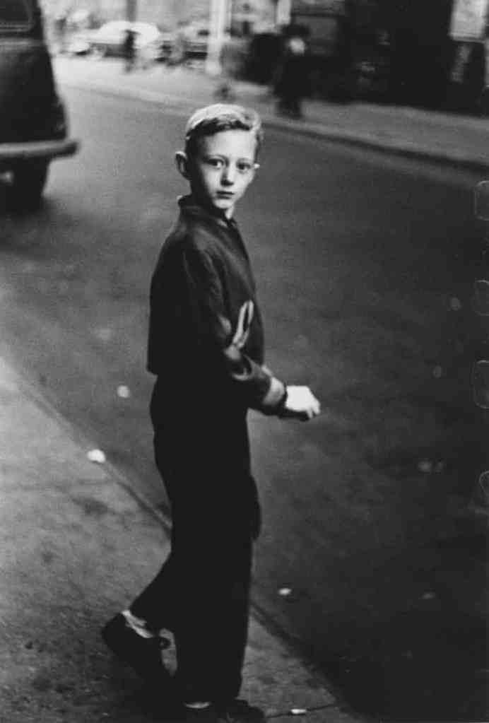 Startled boy in street by Diane Arbus