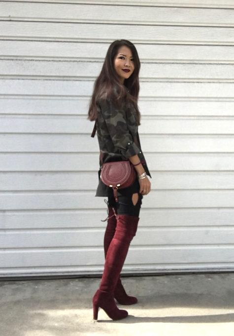 Jenny is wearing a camo jacket and burgundy otk boots with a burgundy Chloe Mini Marcie bag