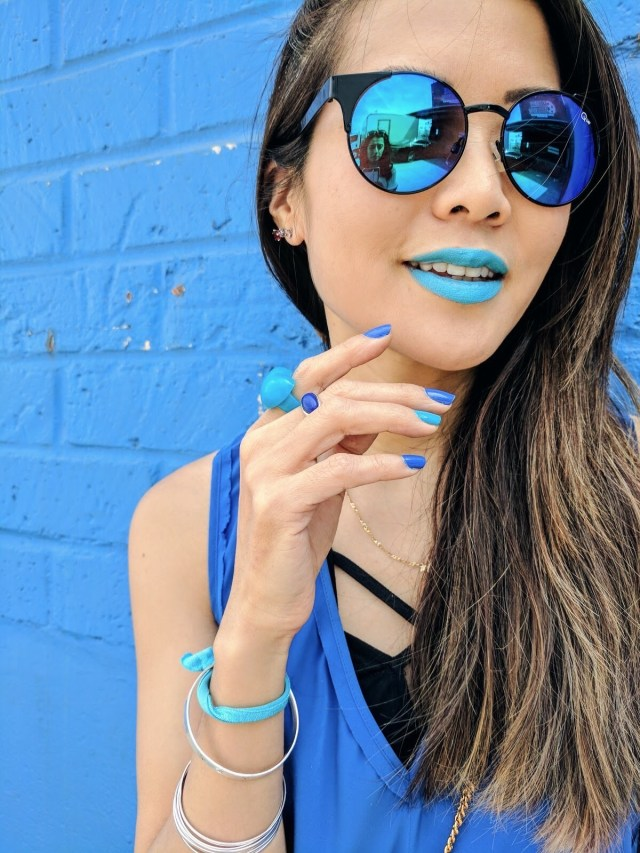 girl wearing blue sunglasses and blue lipstick on google pixel commercial