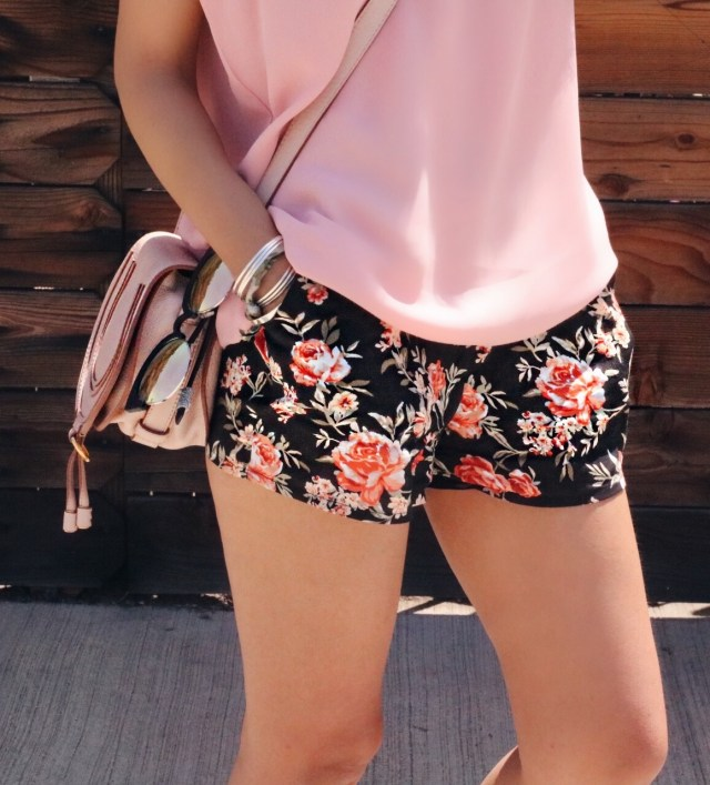 pink top and floral shorts