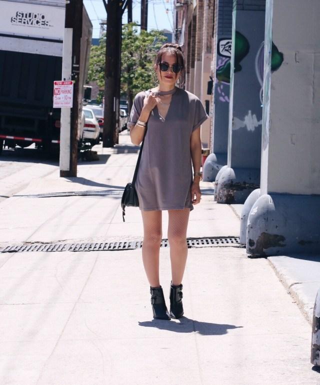 girl wearing tshirt dress walking down street