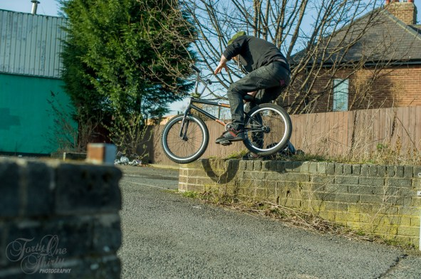 Olly with the footplant, frame grab, bar spin
