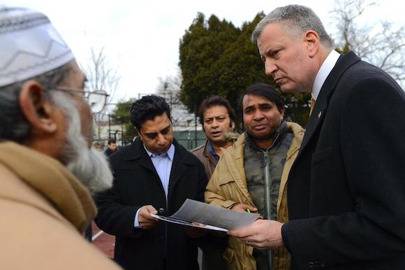 Mayor Bill de Blasio speaks with the family of Noshat Nahian, an 8-year-old killed while walking to school last month. Photo: NYC Mayor's Office
